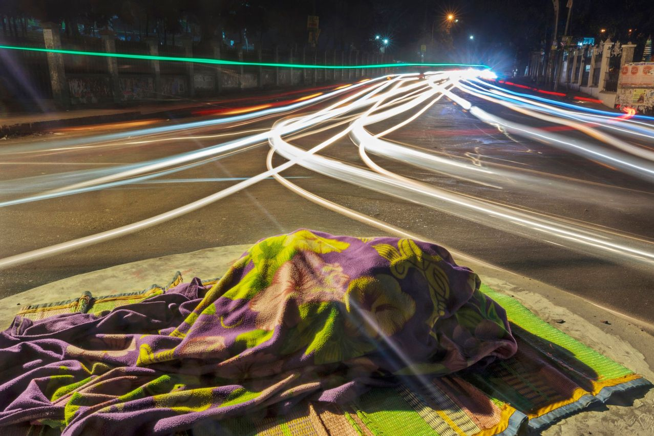 Amena, 20. She has grown up in footpaths since childhood. She used to pass night in different parks of the city. But now she can not sleep in parks due to a government prohibition. So she now sleeps either on road dividers or in roundabouts. The photo was taken from Love Lane area of Chattogram city on January 17, 2018