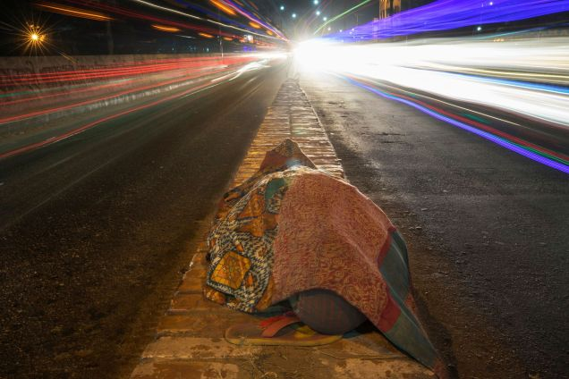 Ali Hossain, 35. He does work of a day labourer in Falmundi, the biggest fruit trading hub of Chattogram city. In night, he sleeps at different points of Station Road of the city. The photo was taken from Station Road area on January 26, 2018